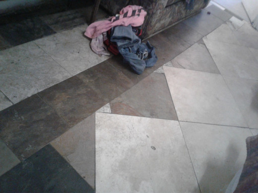 Chipped tile floor - much more sanitary than carpet