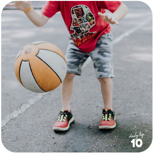 Basketball is a good sport of choice as it is is fun and can help keep your kid active.