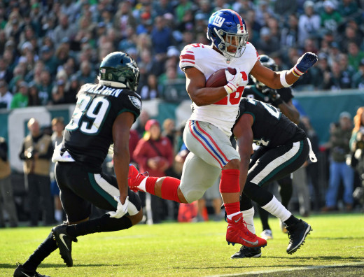 New York Giants running back Saquon Barkley (26) scores on a 13-yard touchdown catch against the Philadelphia Eagles during the first quarter at Lincoln Financial Field, November 25, 2018.