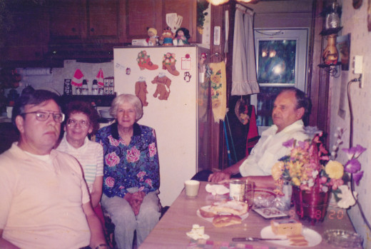 In Aunt Sissy's home.  From left to right: author, Aunt Sissy, mom, and dad.  Taken around 1993