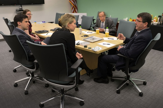 Deputy Secretary of Defense Ashton B. Carter and former Secretary of Defense William Perry meet Theranos CEO and founder Elizabeth Holmes in 2013.