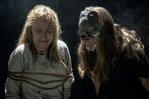 Linnea Quigley (L) is about to meet her maker, thanks to Mom (Maria Olsen) in Trophy Heads