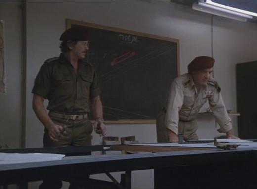 Bronson plots his next move in Raid on Entebbe.