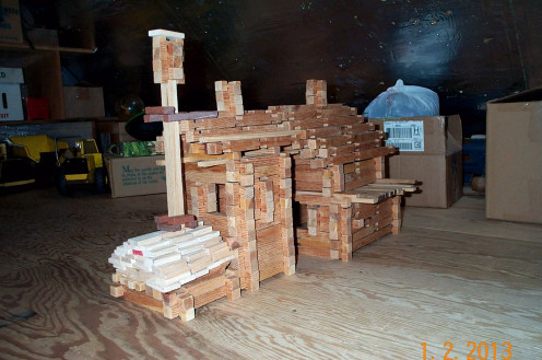 This is a homemade Lincoln log set. A good building set induces architectural innovation, not frustration or mundane floor plans.