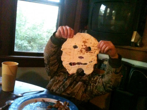 Being allowed to play with ones food can be harmless and creative. Tortilla masks with the features bitten into them  make my daughter giggle.