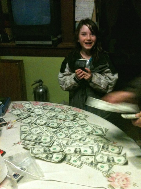 My daughter completed a special job for someone, and was paid in one dollar bills . . . both to make smiles and to help her connect the numbers with an actual amount. It worked!