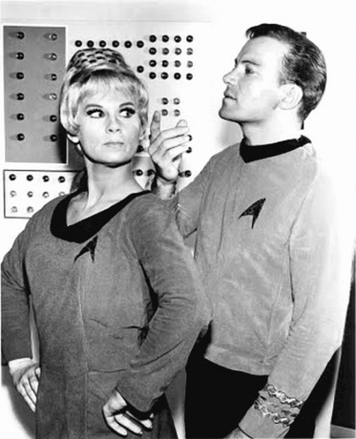 Captain James T. Kirk (William Shatner) and Yeoman Janice Rand (Grace Lee Whitey).