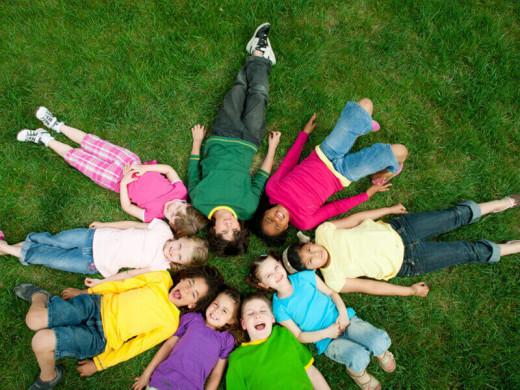 Circle of kids on grass