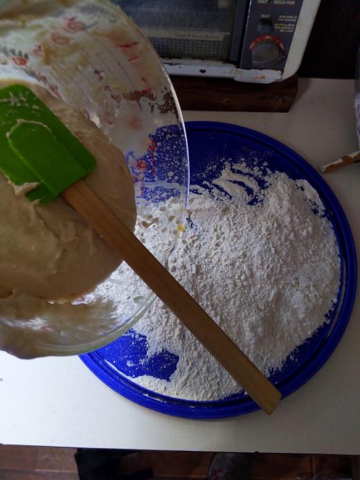 Scrape glob out of bowl onto flour