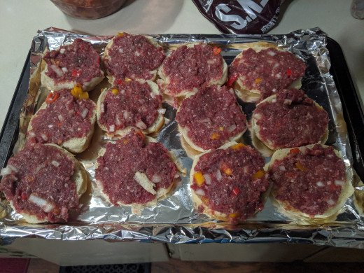 Buns with meat mixture spread on them