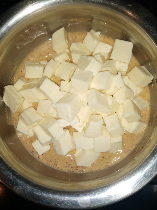 To this batter add cubed paneer.