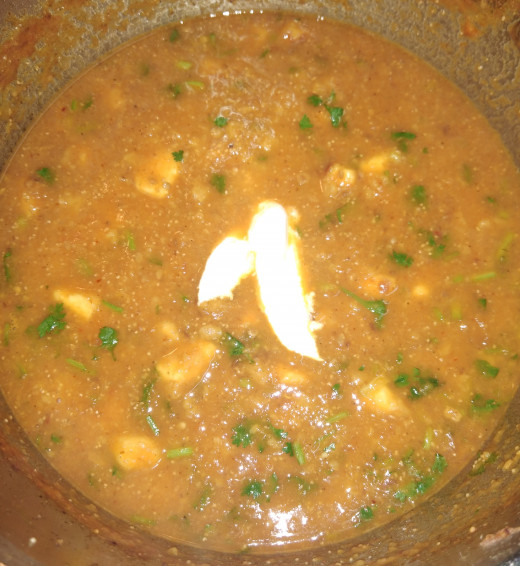 Add 1-2 teaspoons of fresh cream. Gently mix the cream in the gravy.