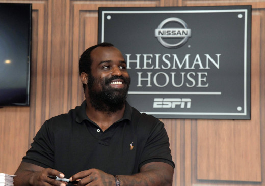 Former Miami Dolphins running back and 1998 Heisman Trophy winner, Ricky Williams, signs autographs at the ESPN Heisman House at Darrell K. Royal-Texas Memorial Stadium in 2018.