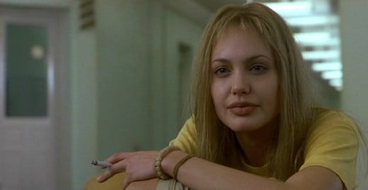 Angelina Jolie as Lisa from 'Girl, Interrupted' (2016), a character with anorexia and a personality disorder. I would argue that the eating disorder is glamorized in this film.