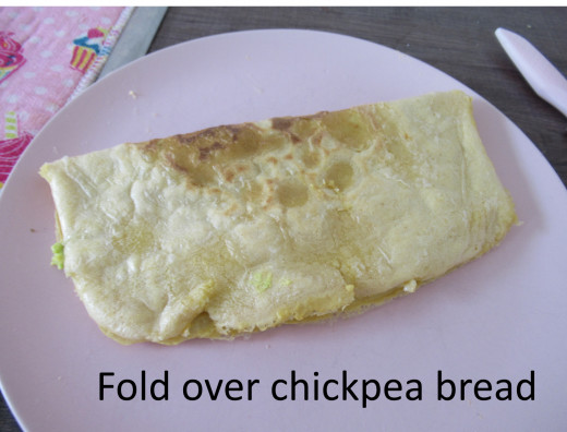 Fold over the chickpea bread