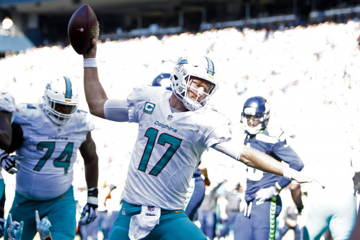 Miami Dolphins quarterback, Ryan Tannehill, celebrates after rushing for a touchdown against the Seattle Seahawks in 2016. Tannehill is the franchise leader in rushing yards among quarterbacks.