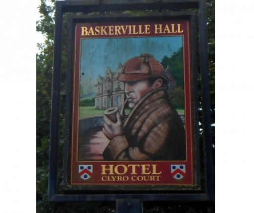 Sherlock Holmes portrayed on Baskerville Hall Hotel sign in Clyro, Wales