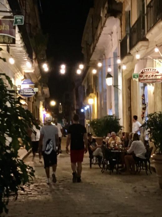 Cuban cobblestone street and outdoor restaurant
