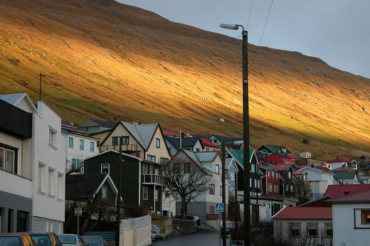 The setting sun adds drama to the town of Vagur in the Faroe Islands
