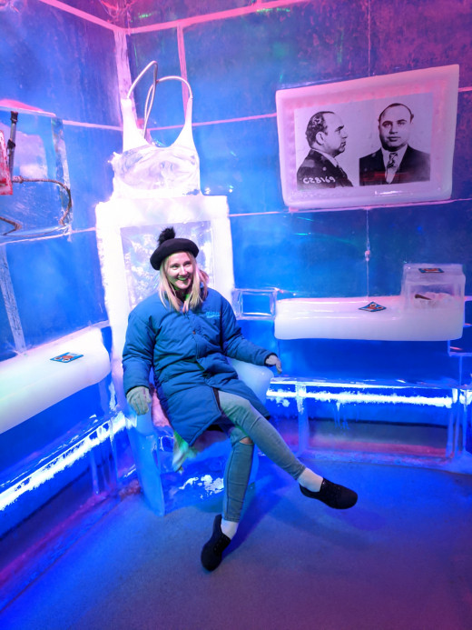 """Our daughter in ice model of electric chair in the """"Mob Museum"""" corner of the room."""