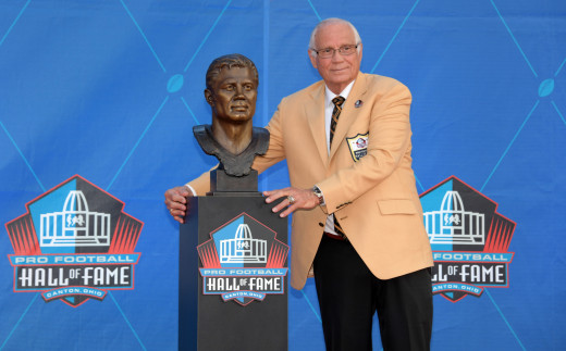 Aug 3, 2019; Canton, OH, USA; Johnny Robinson poses with bust during the Pro Football Hall of Fame Enshrinement at Tom Benson Hall of Fame Stadium.