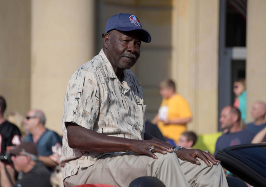 Aug 4, 2018; Canton, OH, USA; Kansas City Chiefs former defensive back Emmitt Thomas acknowledges the crowd during the Pro Football Hall of Fame Grand Parade on Cleveland Avenue.