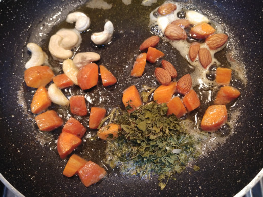 To this add cashews, almonds and kasuri methi ( instead of kasuri methi you can use celery leaves or water cress).
