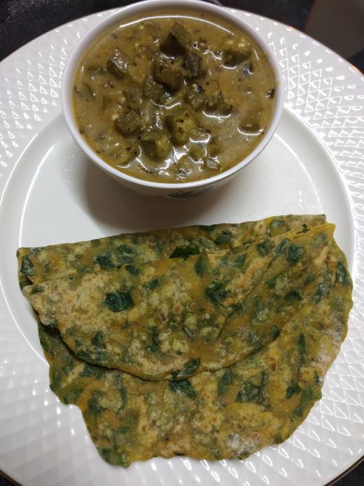Methi or Fenugreek leaves paratha with ladies finger in yogurt gravy.