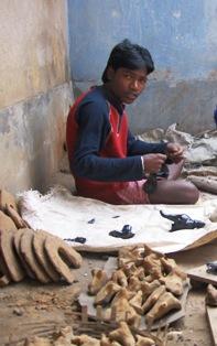 Artist starting the 'make' the core of a 'Ganesha' idol.