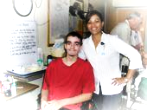 Jared at the TBI hospital with his favorite nurse who taught him how to walk again.