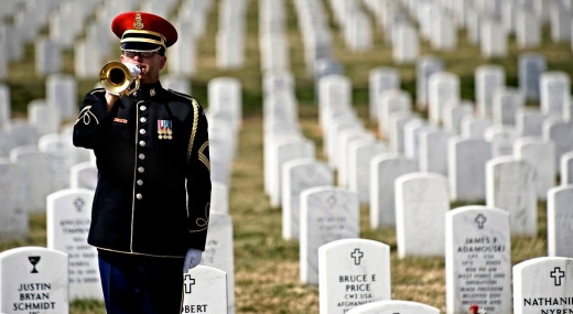 """A bugler sounds """"Taps"""" at Arlington National Cemetery on Memorial Day--a solemn occasion, but this holiday doesn't produce much music"""