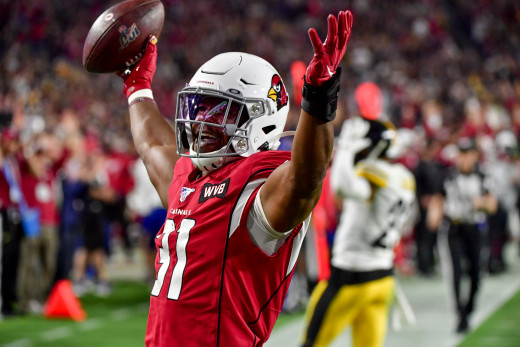 Arizona Cardinals running back, David Johnson (31), celebrates after scoring a touchdown during the second half of a 2019 game against the Pittsburgh Steelers at State Farm Stadium.
