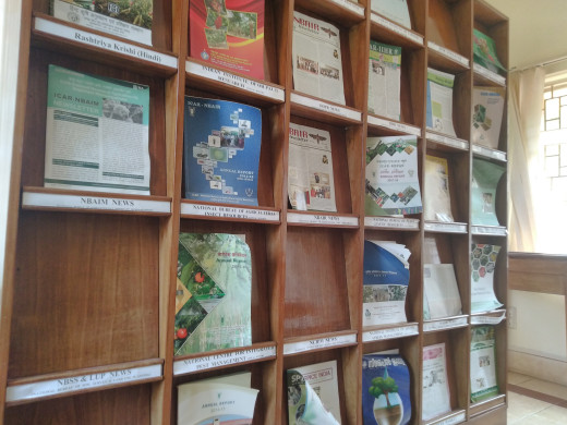 Volumes of agricultural magazines on a library shelf