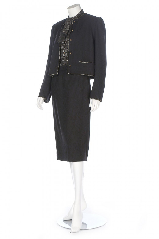 A Chanel Creations black wool-blend suit, early 1980s.