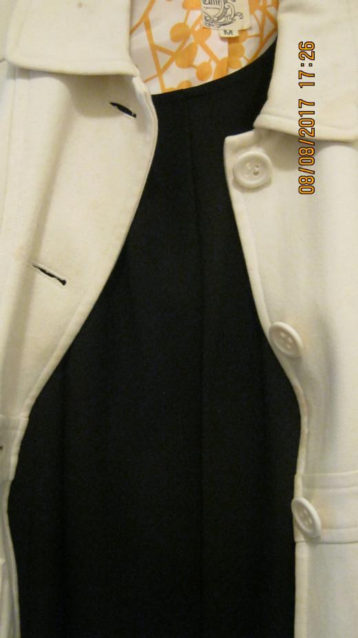 White wool vintage coat over back dress