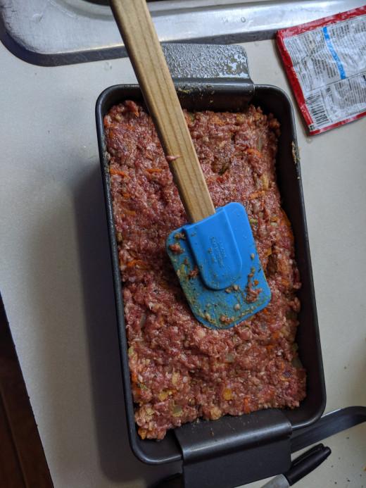 Flatten meatloaf mixture in pan