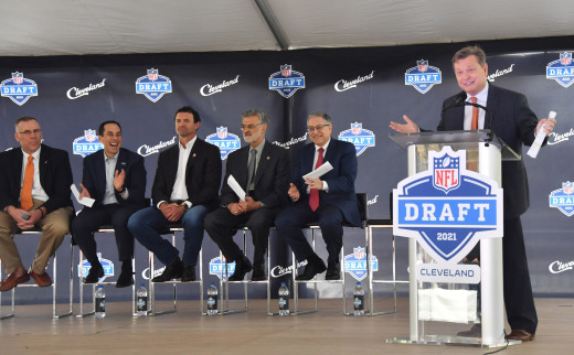 Radio voice of the Cleveland Browns, Jim Donovan (right), speaks during a press conference in Public Square to announce Cleveland as the host of the 2021 NFL Draft. Since joining the NFL in 1950, the Browns have made plenty of memorable draft picks.