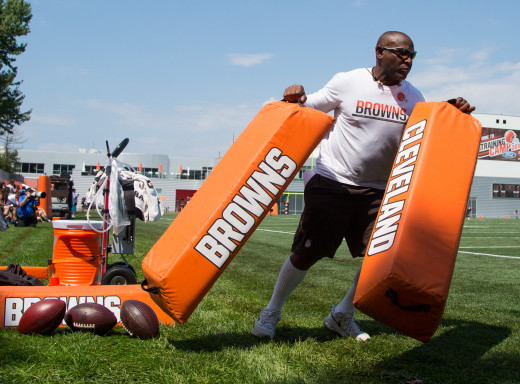 Former Cleveland Browns running back, Earnest Byner, drags pads out to the field at the team's training facility in Berea during training camp in 2016. Byner was a 10th-round pick in 1984, but became a star for several Browns playoff teams.