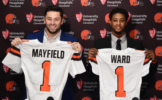 Cleveland Browns first-round picks, Baker Mayfield (left) and Denzel Ward, show off Browns jerseys during a press conference after the 2018 NFL Draft. That year marked the ninth time Cleveland had multiple first-round picks in the same draft.