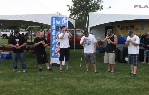"This is a crushed ice drinking contest in Canada. The person who finishes their slurpee first is the winner. The drink is not known as a ""brain freezer"" for nothing!"