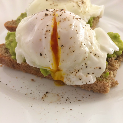 A Tasty Breakfast: Poached eggs and creamy avocado on toasted brown soda bread