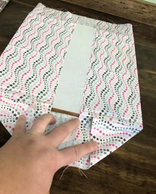 Fold other two ends in a triangular shape as shown, them fold in, staple.