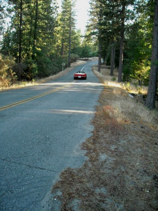 This red Corvette passed me so fast one day, I almost missed the shot. Traffic is light here... and no traffic lights.