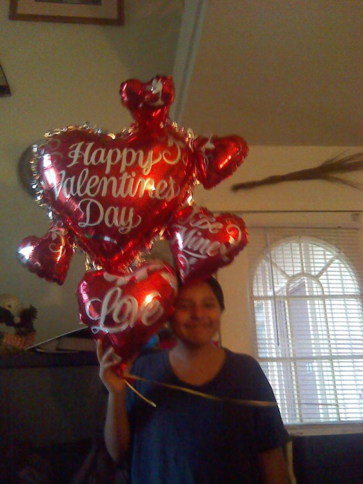 My baby at 15 ! So sweet. He was so happy bringing me the balloons.