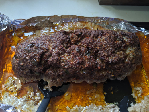 Loosen meatloaf and remove to different cutting board, away from grease