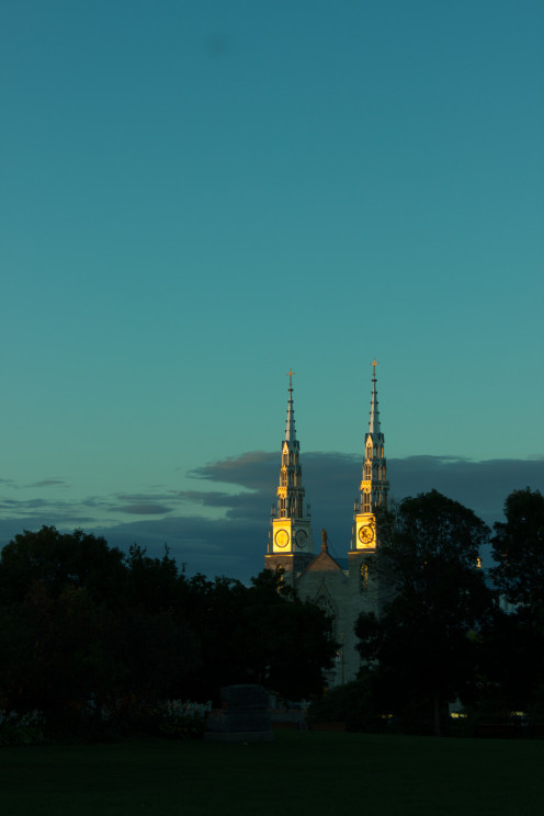 The basilica cathedral Notre Dame in Ottawa at sunset as seen from Major's Hill Park.