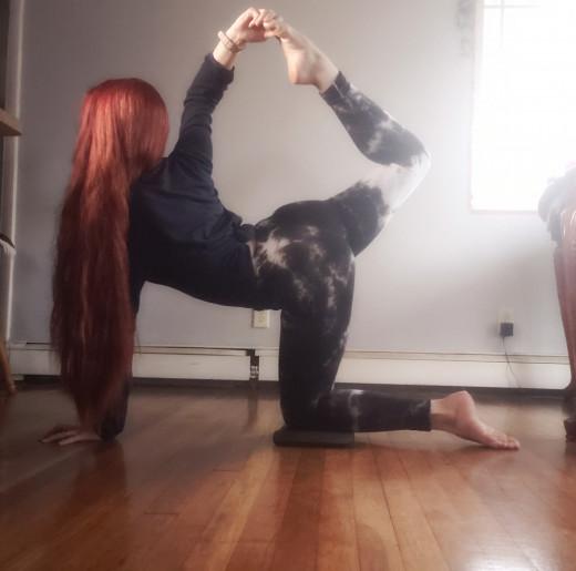 Working on shoulder flexibility with a flipped grip in tiger pose.