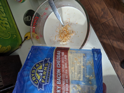 Put some of the shredded cheese directly in the milk soup mixture