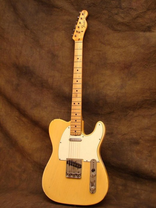 As you can see, maple necks were used again in the 70's and were very popular. Natural wood finished Strats and Teles were very common. Also notice the larger Fender decal and writing on the headstock - a 70's Fender trademark.