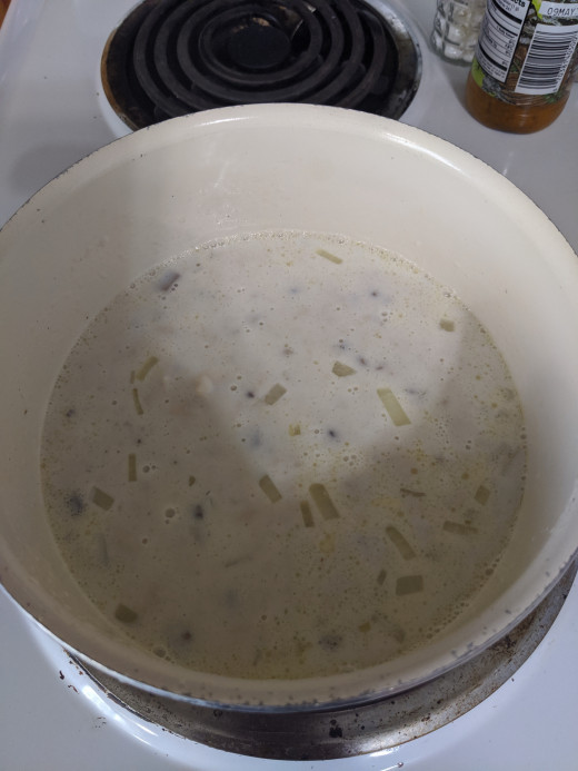 Add milk, cream of mushroom soup and a can of Mexican corn
